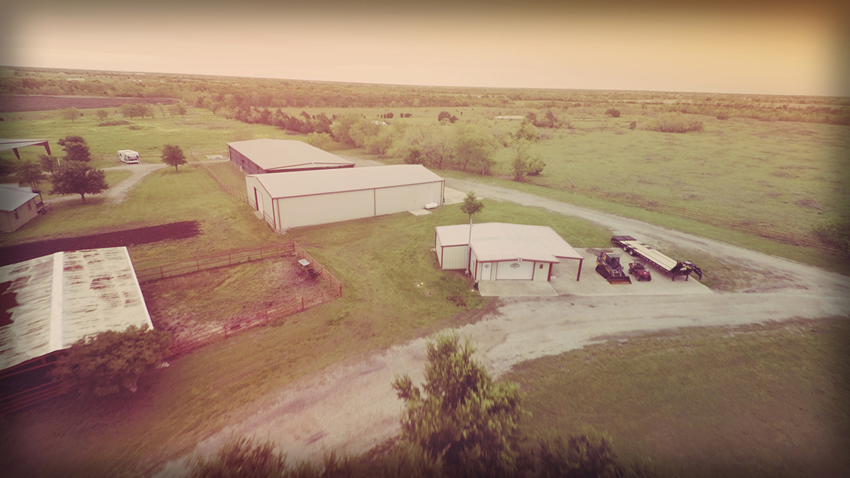 Lonesome Dove Ranch - Aerial of the shop, hay barn, and stable