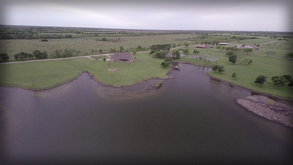Lonesome Dove Ranch - Aerial of the lake, caretaker's house and tennis courts